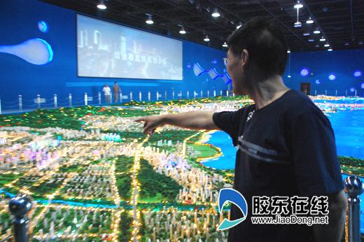 """市域城镇体系形成""""一带一轴""""的空间结构"""