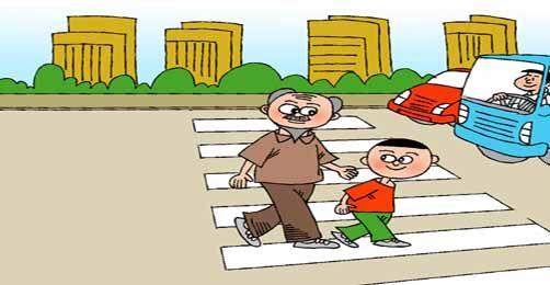 一定要注意交通信号灯,而且过马路时一定要走人行横道.图片