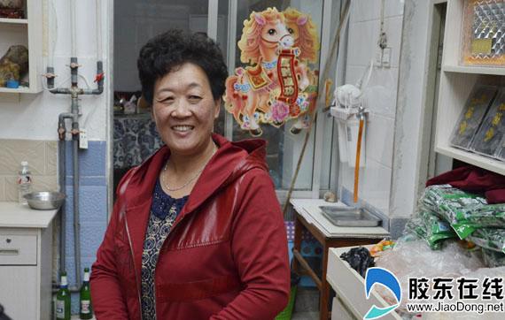 长岛渔家乐经营者贾平认为城铁通车对长岛旅游业是一件大好事
