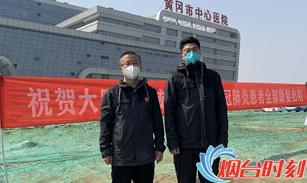 烟台市第一批支援湖北医疗队队员、毓璜顶医院呼吸与危重症医学科副主任姜廷枢(左)及重症医学科护士任福磊(右)